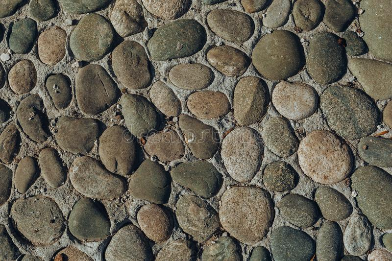 Pebble or shingle seamless texture or background. Old stone stock photography