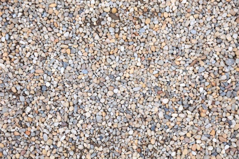 Pebble gravel stone ground floor small pattern smooth texture beach wallpaper rock texture zen background round nature landscape stock photography