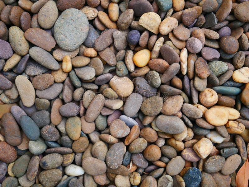 Pebble stone background, aroma stone in nature garden. Pebble stone pattern.pebbles beach stone outdoor garden , rock sand nature background royalty free stock photos