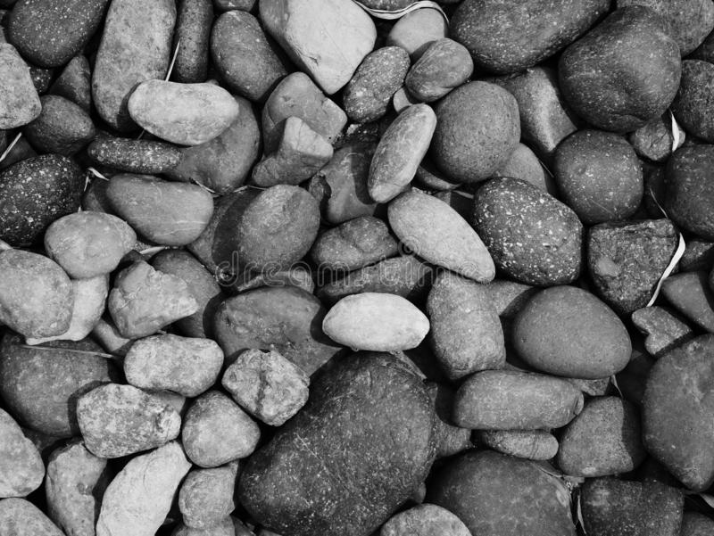 Pebble stone background, aroma stone in nature garden. Pebble stone pattern.pebbles beach stone outdoor garden , rock sand nature background stock photo