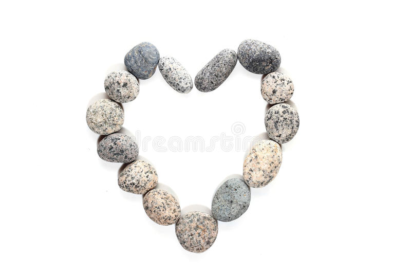 Pebble stone in heart shape stock photo