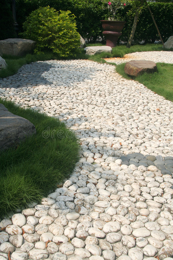 Pebble Stone path. In the garden royalty free stock photos