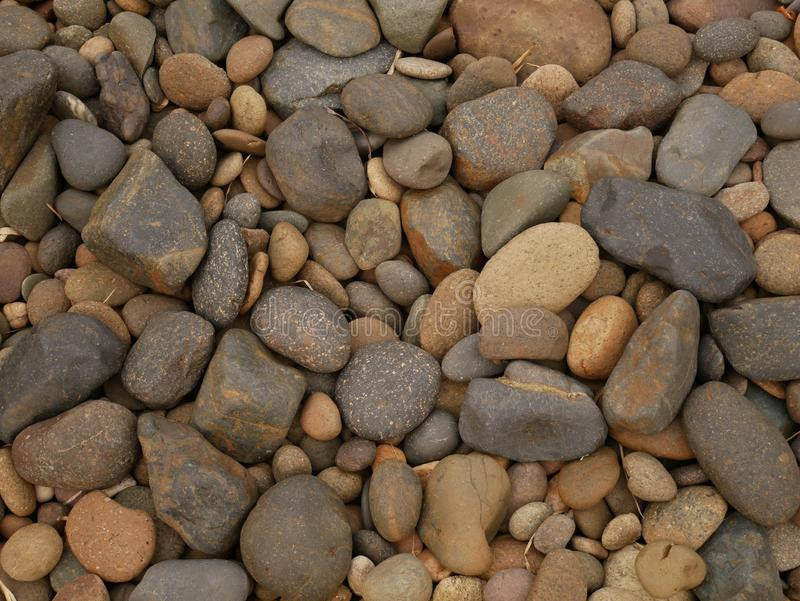 Pebble stone background, aroma stone in nature garden. Pebble stone pattern.pebbles beach stone outdoor garden , rock sand nature background stock photography