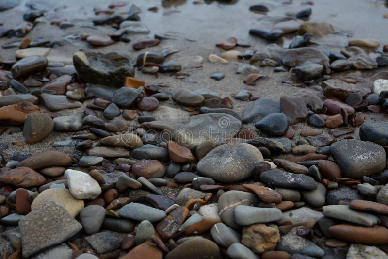 Pebble stones on the river shore. Closeup.  royalty free stock photo