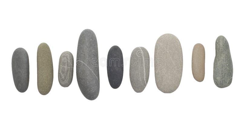Pebble stones on white stock photos