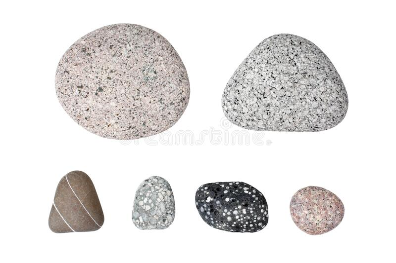 Pebble stones on white background isolated close up top view, set of smooth sea pebbles, rubble collection, different cobblestones. Pebble stones on white stock photography