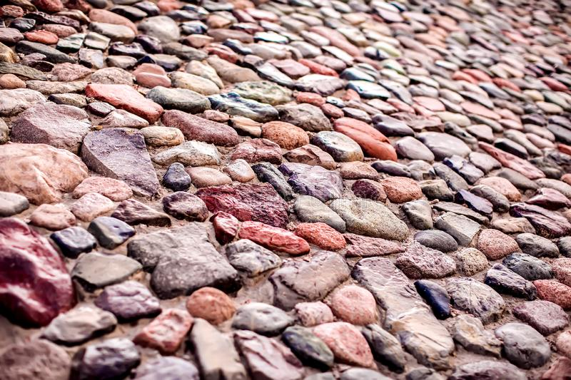 Pebble wall are made of stones of different sizes stock image