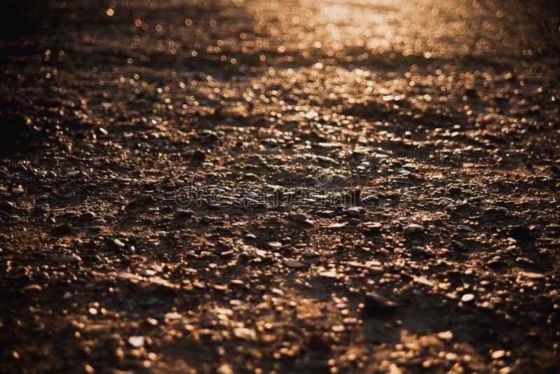 Pebbledgrond bij zonsondergang royalty-vrije stock afbeeldingen