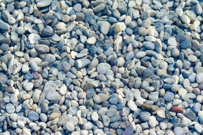 Pebbles. Background under water surface stock photos