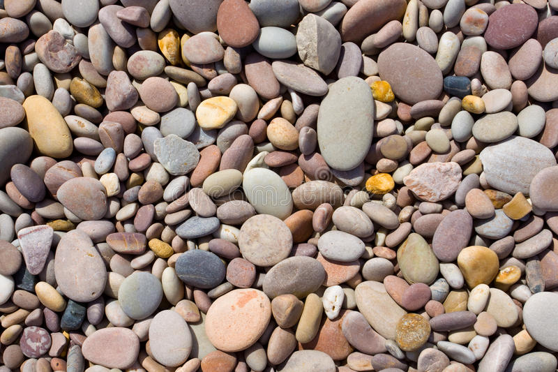 Pebbles. Laid out on a beach royalty free stock image