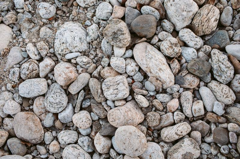 Pebbles as texture and background for design. Abstract background made with small stones. royalty free stock photos