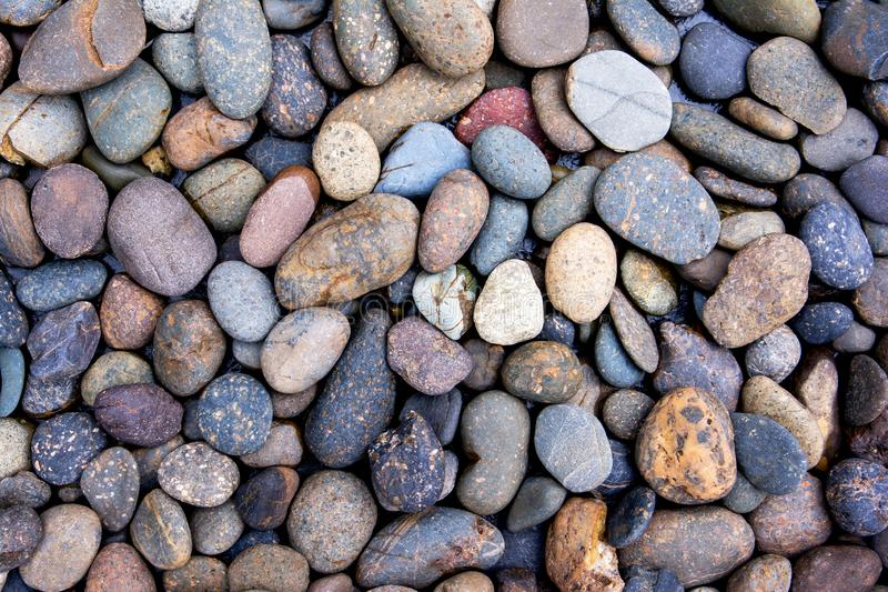 Pebbles background. Gravel background. Colorful pebbles background royalty free stock photos
