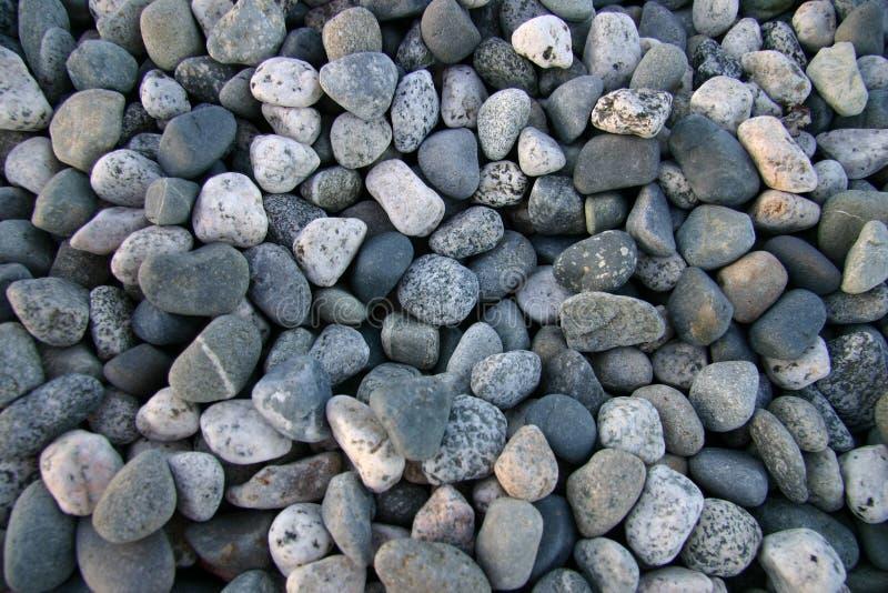 Pebbles on beach stock photos