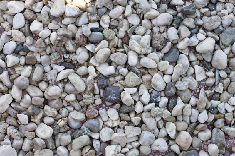 Pebbles on the beach, a huge number of stones,. Backgrounds, textures, pebbles, pebble beach, stone texture background stock photography