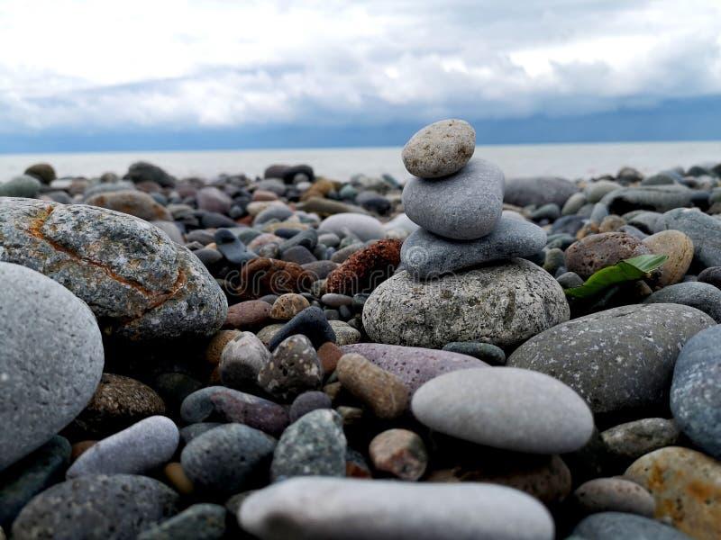 Pebbles on the beach close-up. sea coast royalty free stock photography