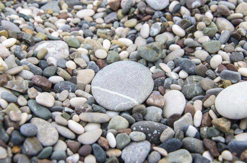 Pebbles with big stone closeup stock photos