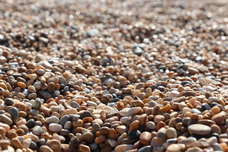 Pebbles. This is a close up image I took of the pebbles whilst chilling on the beach. It focuses on the central, foreground of the pebbles and blurs out the back royalty free stock photos