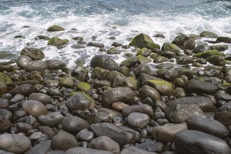Pebbles ocean shore royalty free stock images