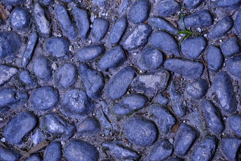 Pebbles, paving stone, natural ground. Good quality close up photo of a paving stone road somewhere in old part of a city: you may see beautiful cobblestones stock photos