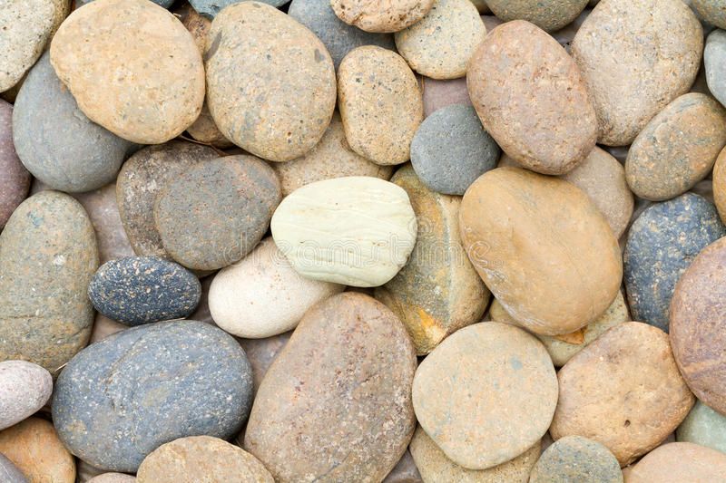 Pebbles. Round nature pebbles background top veiw royalty free stock image