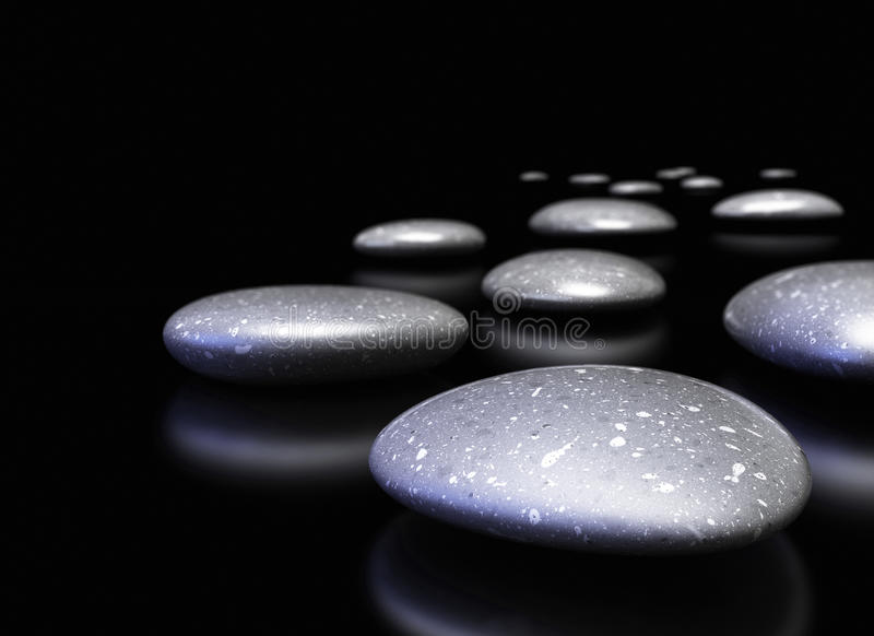 Pebbles in a row over black background