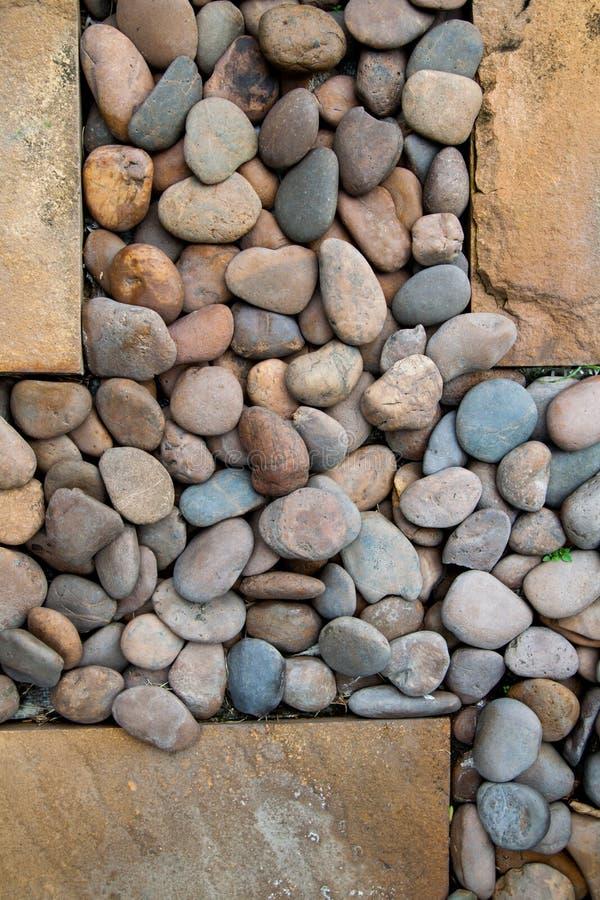 Download Pebbles Som En Bakgrundsbild Arkivfoto - Bild av trädgård, modell: 27284714