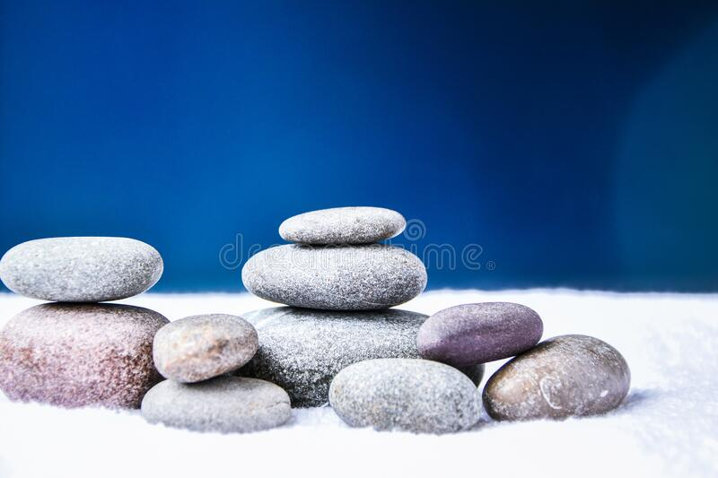 Pebbles stack, Balance, Pyramid of stones for meditation, stack of zen stones, copy space, spa. Treatment concept stock photo