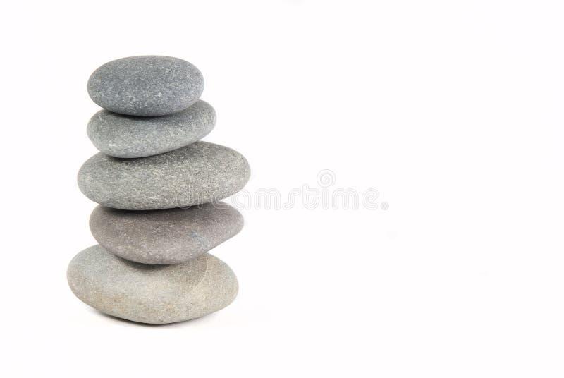 pebbles staplade yoga royaltyfria foton