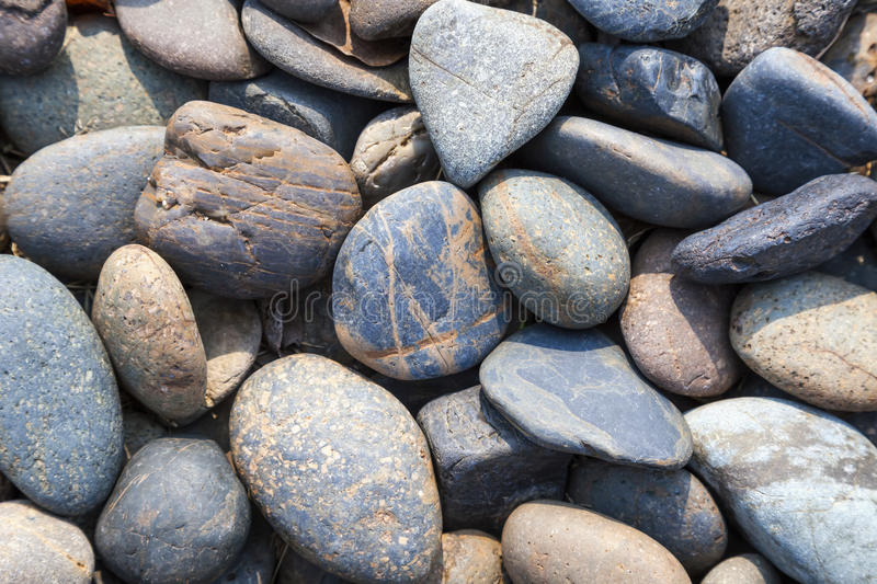 Pebbles stones Natural background at seashore stock photography