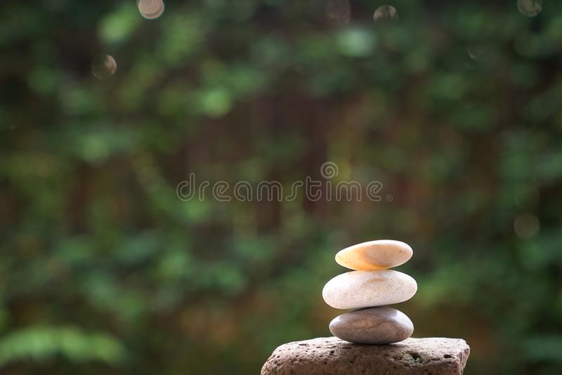 Pebbles or stones stacked up stock photo
