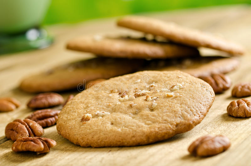Pecan Cookies. Delicious home made pecan cookies with whole pecan and milk royalty free stock photo