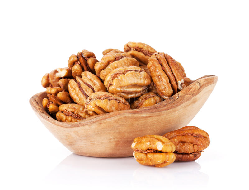 Pecan nuts. In bowl. Isolated on white background stock photos