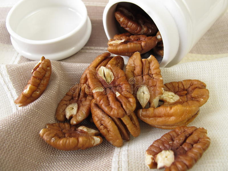 Pecan nuts. In porcelain tin royalty free stock photos