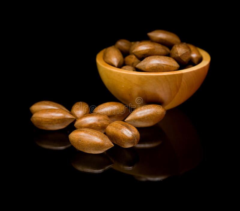 Pecan nuts in small wooden bowl royalty free stock photo