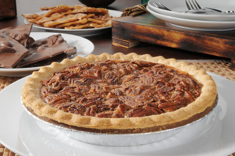 Pecan pie. A pecan pie with chocolate bark and peanut brittle royalty free stock images