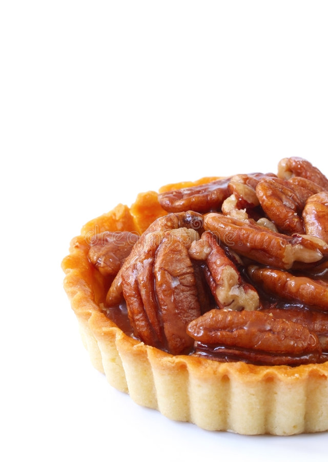 Pecan Pie. Small pecan pie or tart, isolated on white royalty free stock photography
