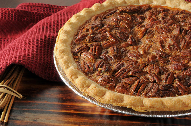 Pecan pie close up. Close up shot of a pecan pie cooling on a chopping block royalty free stock photography