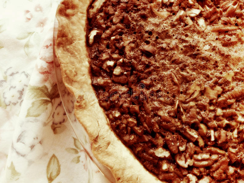 Pecan pie with floral napkin stock photography