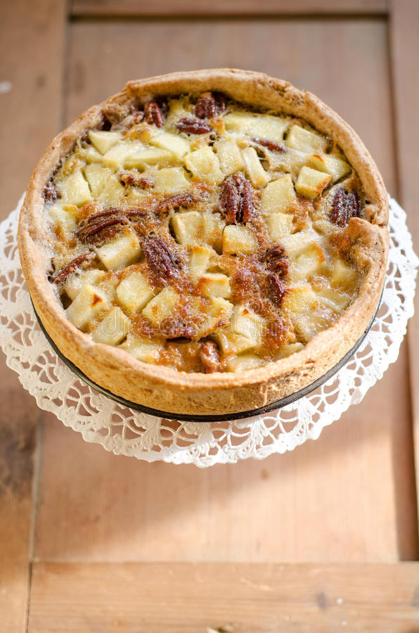 Pecan pie. Traditional apple and pecan pie on cake stand royalty free stock image
