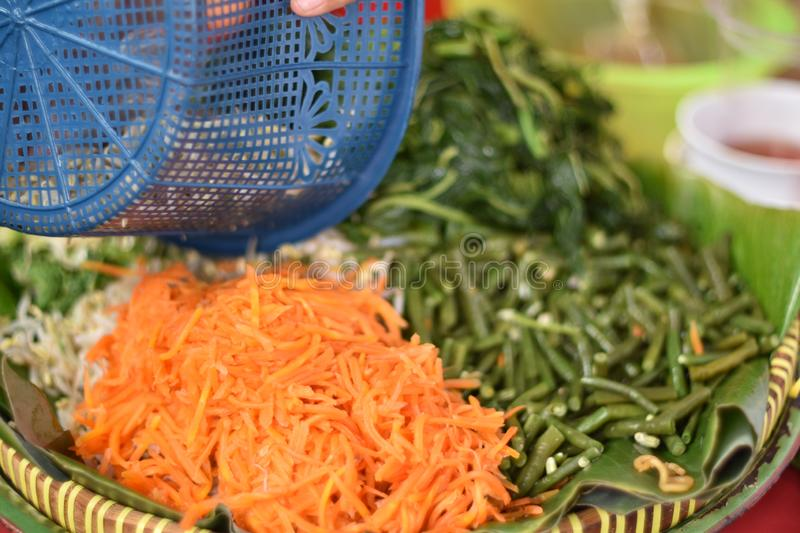 Pecel is traditional food from Indonesia made from Steamed vegetable served with peanut sauce stock photos