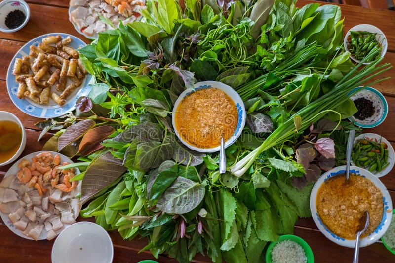 Peculiar herbs salad in Kon Tum, Vietnam. Using the leaves to make a cone-shaped container to put the food in, and use some bacon, stock photos