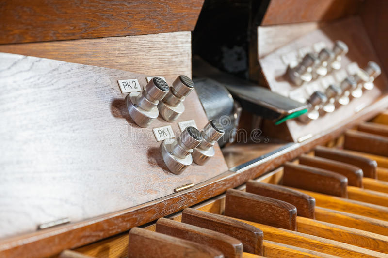 Pedal organ music. Keyboard and pedal organ close-up royalty free stock photo