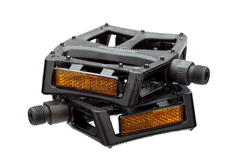 Pedale mit einem hellen Reflektor lizenzfreie stockbilder