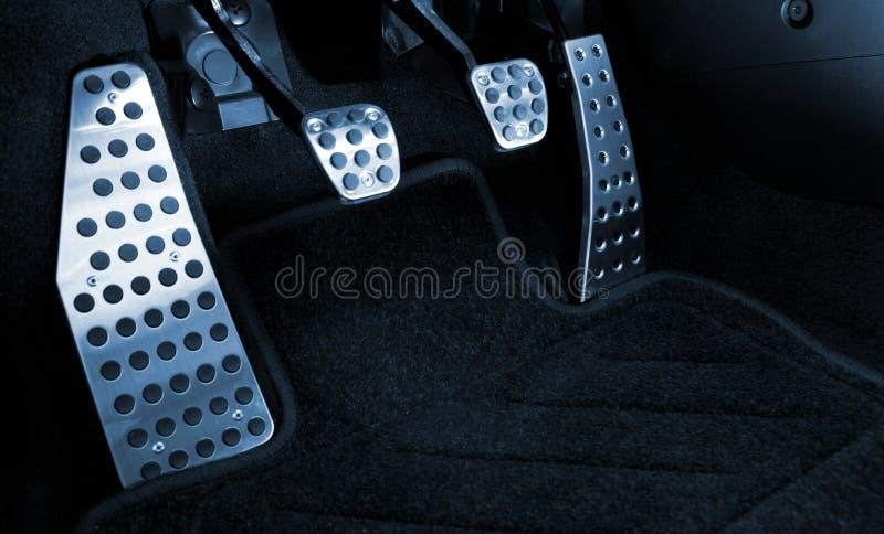 Pedales del cromo del coche deportivo imagenes de archivo