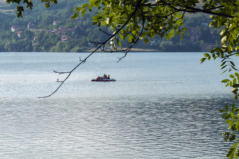 Pedalo - paddle boat sail on the lake at sunny day royalty free stock image
