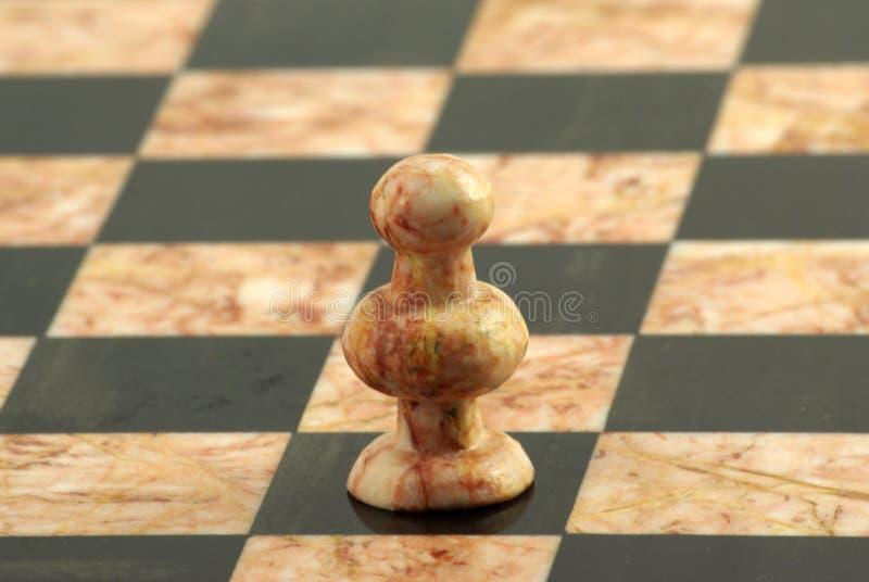 Pedazo de ajedrez, empeño blanco fotos de archivo