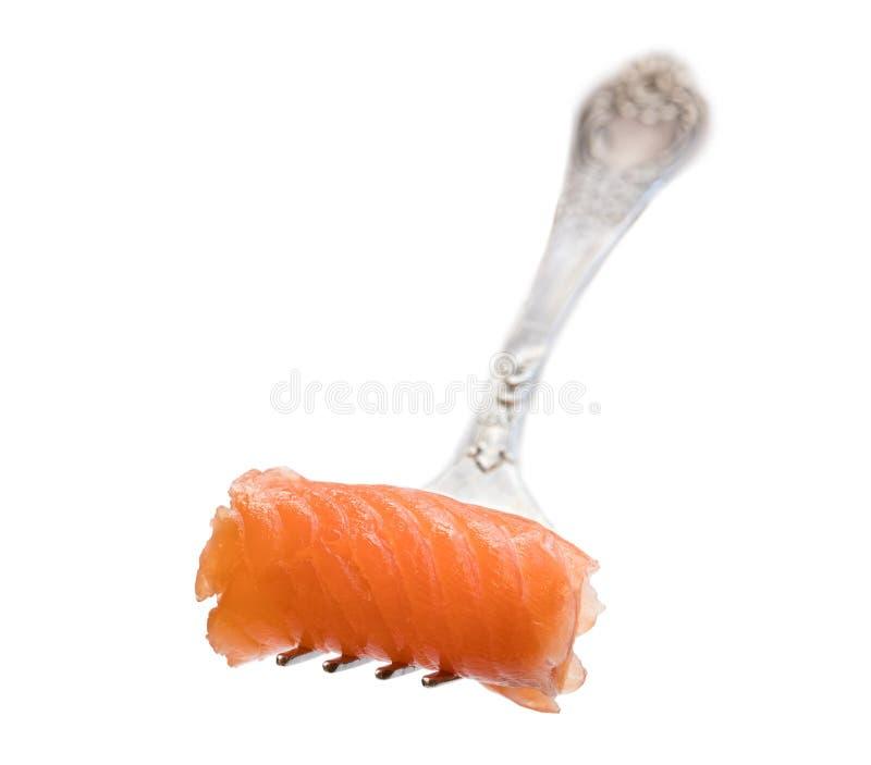 Pedazo de color salmón rodado en la bifurcación aislada en blanco imagen de archivo libre de regalías