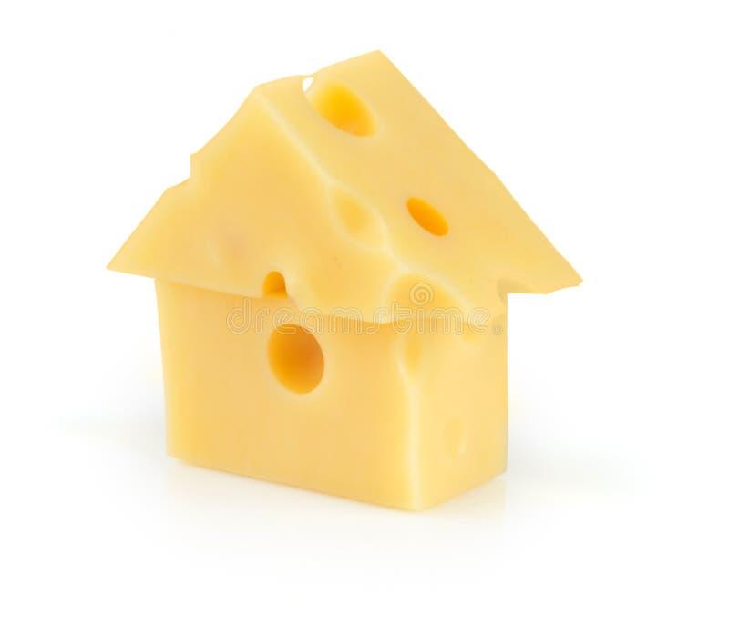 Pedazo de queso poroso amarillo fotos de archivo libres de regalías