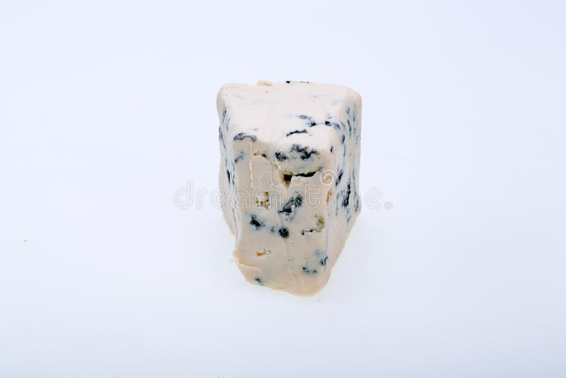 Pedazo de queso verde imagenes de archivo