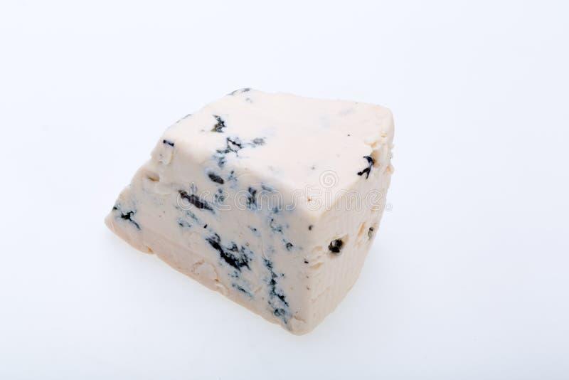 Pedazo de queso verde imagen de archivo